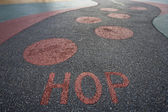 """Hop"" written into rubber floor — Stock Photo"