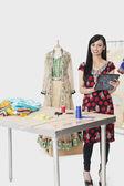 Dressmaker at design studio — Stock Photo