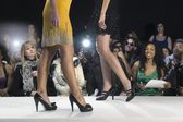Women walking on fashion catwalk — Stock Photo