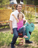 Father and daughter on playground — Stock Photo