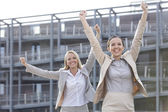 Businesswomen with arms raised — Stock Photo