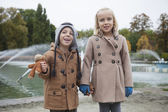 Brother and sister in trench coats — Stock Photo