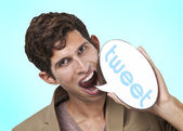Man holding tweet word bubble — Stock Photo