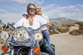 Senior couple on motorcycle — Stock Photo