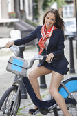 Young businesswoman with bicycle — Stockfoto