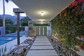 Tiled foothpath leading to door — Stock Photo