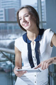 Businesswoman holding tablet device — Stock Photo
