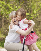 Mother and daughter hug — Stock Photo