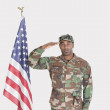 US Marine Corps soldier saluting American flag — Stock Photo #34010627