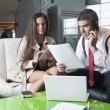 Businessman and businesswoman at meeting — Stock Photo #34012291