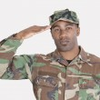 African American US Marine Corps soldier saluting — Stock Photo #34012507