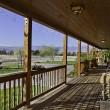 Stock Photo: Ranch porch overlooking horse stables