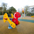 Playground rocking horse — Stock Photo #34012813