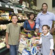 Family shopping in supermarket — Stock Photo #34013139