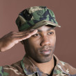 African American US Marine Corps soldier saluting — Stock Photo #34013797
