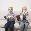 Brother and sister playing video game — Stock Photo #34014171