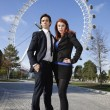 Business couple against London Eye — Stock Photo
