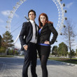 Business couple against London Eye — Stock Photo #34014857