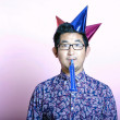 Man wearing many party hats — Stock Photo #34014987