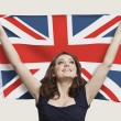 Woman holding British Flag with pride — Stock Photo
