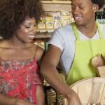 Woman buying peanuts — Stock Photo #34015887