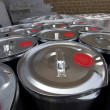 Tins outside warehouse — Stock Photo