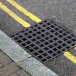Street drain — Stock Photo #34016393