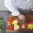 Chef dices peppers — Stock Photo