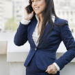 Indian businesswoman using cell phone — Stock Photo #34019169