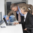 Businesswoman and man looking at laptop — Stock Photo #34019537