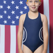 Girl in swimwear in front of American flag — Stock Photo #34019881