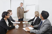 Man using whiteboard in business meeting — Stock Photo