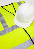 Safety vest and hard hat — Stock Photo