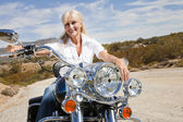 Senior woman sits on motorcycle — Stock Photo