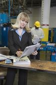 Woman working in newspaper factory — Stock Photo