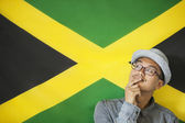 Man against Jamaican flag — Stock Photo