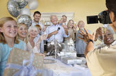 Senior man celebrating start of retirement — Stockfoto