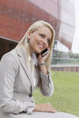 Businesswoman conversing on mobile phone — Stock Photo