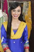 Indian female dressmaker smiling — Foto de Stock