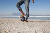 Man foot on ball — Stock Photo