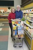 Senior couple doing food shopping — Stock Photo