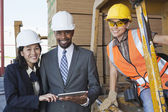 Engineers and industrial worker — Stock Photo