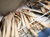 Wooden spatulas on shelf — Stock Photo