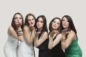 Five young women blowing kisses — Stock Photo