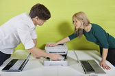 Businesspeople setting up printer with laptops — Stock Photo