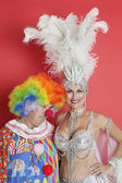 Senior showgirl with sad clown — Stock Photo