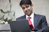 Indian businessman using tablet PC — Stock Photo