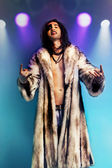 Rock musician in fur coat — Stock Photo