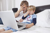 Father and son watching scary movie — Stock Photo