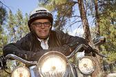 Senior man wearing helmet on motorcycle — Stock Photo